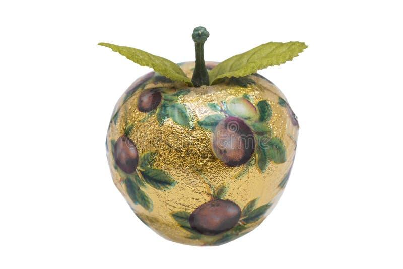 Τεχνητό μήλο φιαγμένο από ξύλο με το χρυσά έγγραφο και το σχέδιο στοκ εικόνες