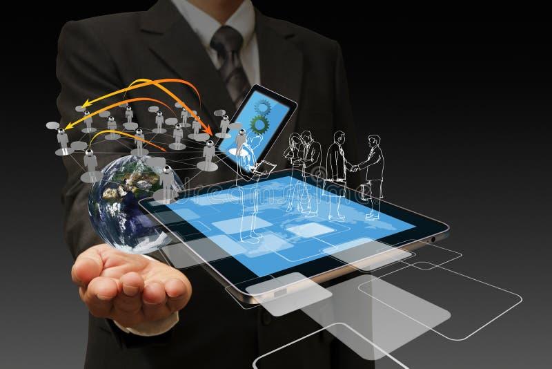 Τεχνολογία στο χέρι των επιχειρηματιών στοκ εικόνες