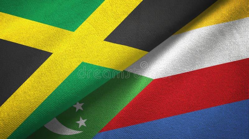 Τζαμάικα και Κομόρες δύο υφαντικό ύφασμα σημαιών, σύσταση υφάσματος απεικόνιση αποθεμάτων