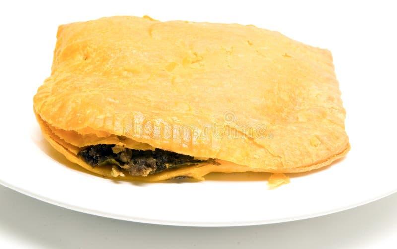 Τζαμαϊκανά τρόφιμα ζύμης βόειου κρέατος pattie τηγανισμένα patty στοκ φωτογραφία