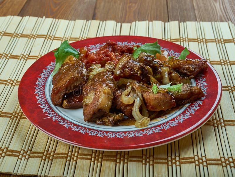 Τζαμαϊκανός ώμος χοιρινού κρέατος τραντάγματος στοκ εικόνες