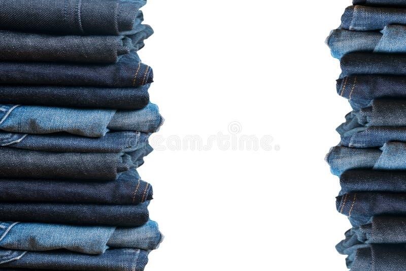 τζιν παντελόνι στην άσπρη συλλογή j υποβάθρου και τζιν τζιν παντελόνι στοκ εικόνες