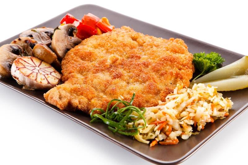 Τηγανισμένη μπριζόλα χοιρινού κρέατος με τα λαχανικά στοκ φωτογραφία με δικαίωμα ελεύθερης χρήσης