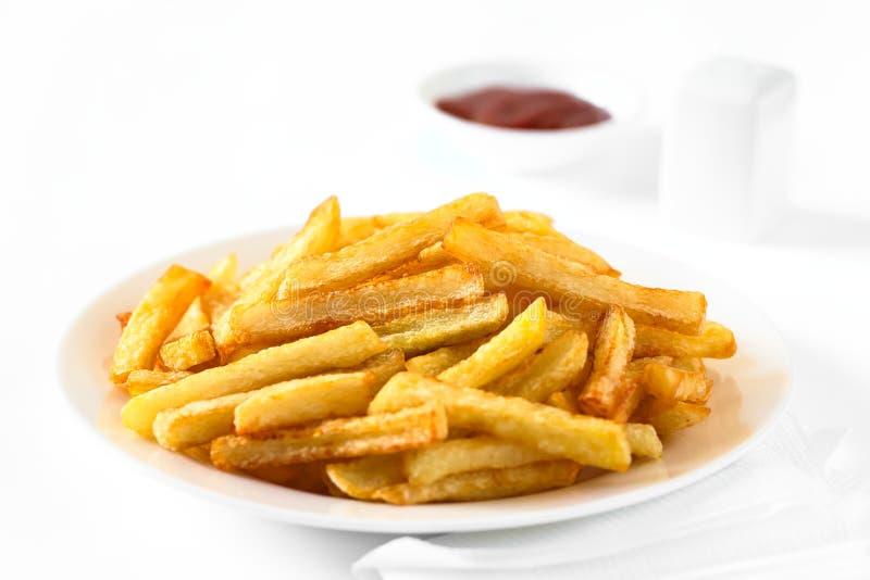 τηγανιτές πατάτες σπιτικέ&sigm στοκ εικόνες