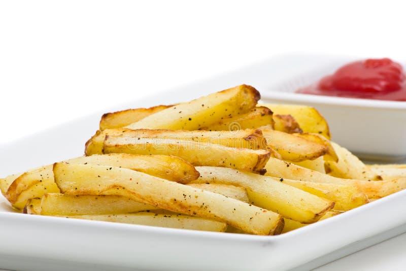 τηγανιτές πατάτες χειροπ&om στοκ φωτογραφίες