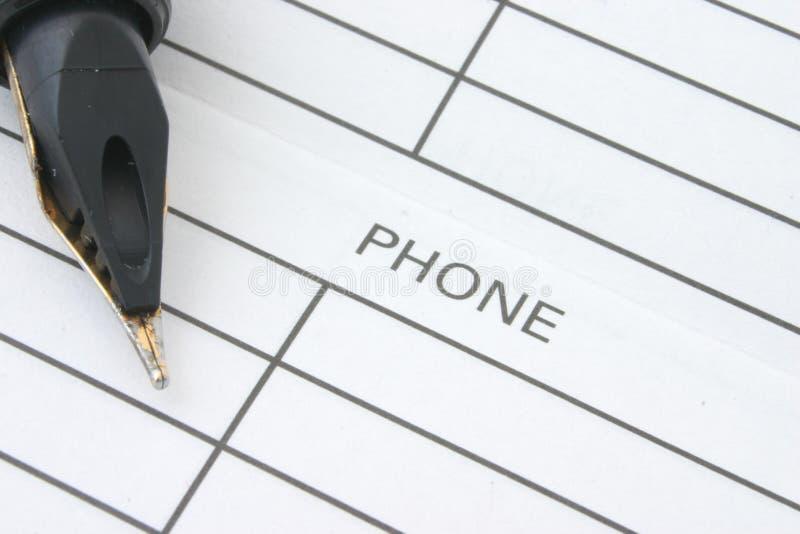 τηλέφωνο βιβλίων προσφωνήσεων στοκ εικόνα