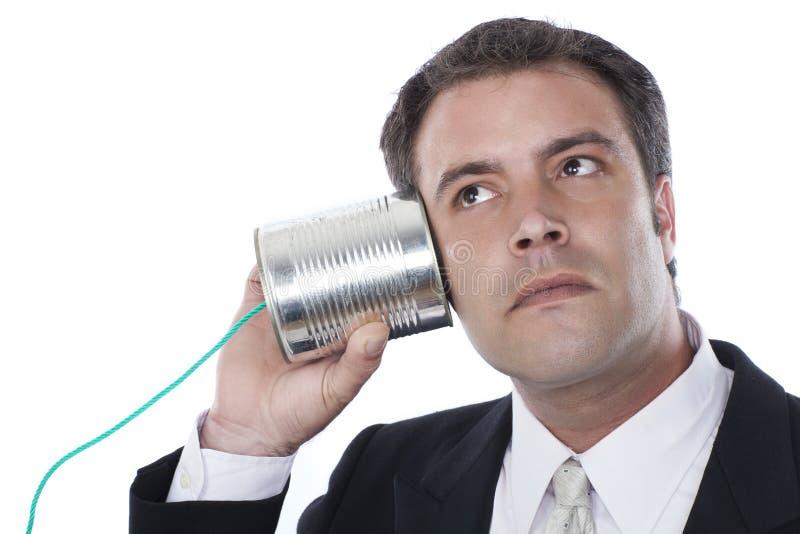 Τηλέφωνο δοχείων επιχειρηματιών και κασσίτερου στοκ φωτογραφία με δικαίωμα ελεύθερης χρήσης