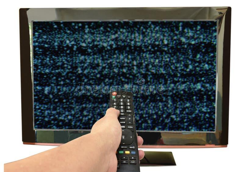 Τηλεοπτικός τηλεχειρισμός εκμετάλλευσης χεριών που δείχνει τη δυσλειτουργία στο υπόβαθρο οθόνης στοκ φωτογραφία