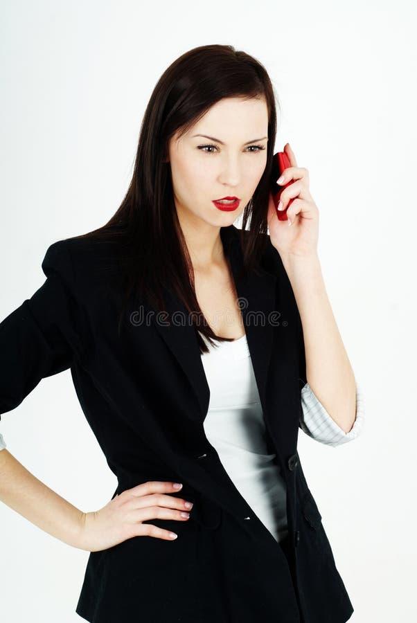 τηλεφωνική ομιλούσα γυναίκαη στοκ εικόνες με δικαίωμα ελεύθερης χρήσης
