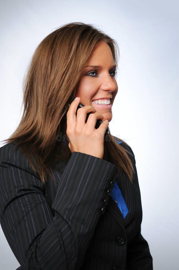 τηλεφωνική ομιλούσα γυν στοκ φωτογραφία