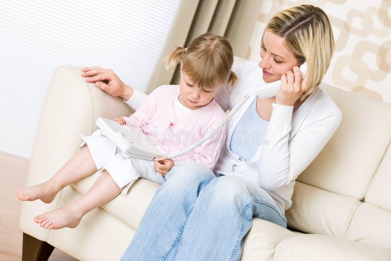 τηλεφωνικό δωμάτιο μητέρων  στοκ εικόνες