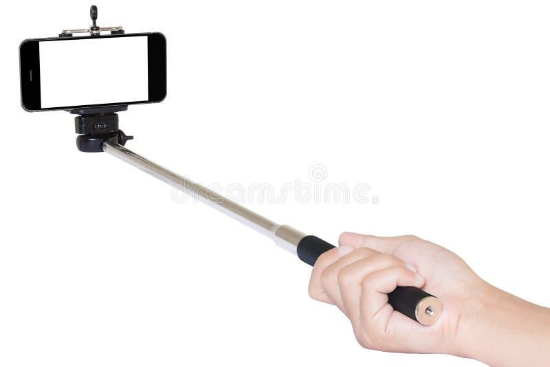 Τηλεφωνικό selfie ραβδί εκμετάλλευσης χεριών που απομονώνεται με το ψαλίδισμα της πορείας στοκ εικόνα με δικαίωμα ελεύθερης χρήσης