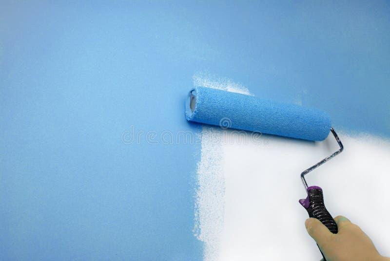 Τοίχος ζωγραφικής χεριών στοκ φωτογραφία με δικαίωμα ελεύθερης χρήσης