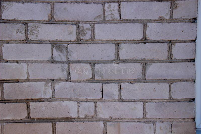 Τοίχος με την πλινθοδομή τούβλα γκρίζα στοκ εικόνα