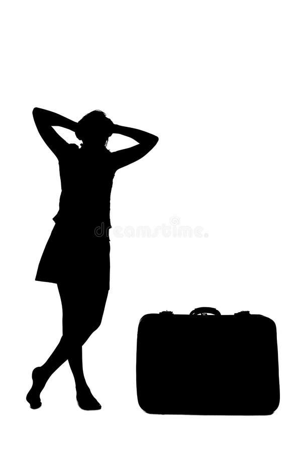 Τονισμένη σκιαγραφία γυναικών - κοντά σε αποσκευές στοκ εικόνες
