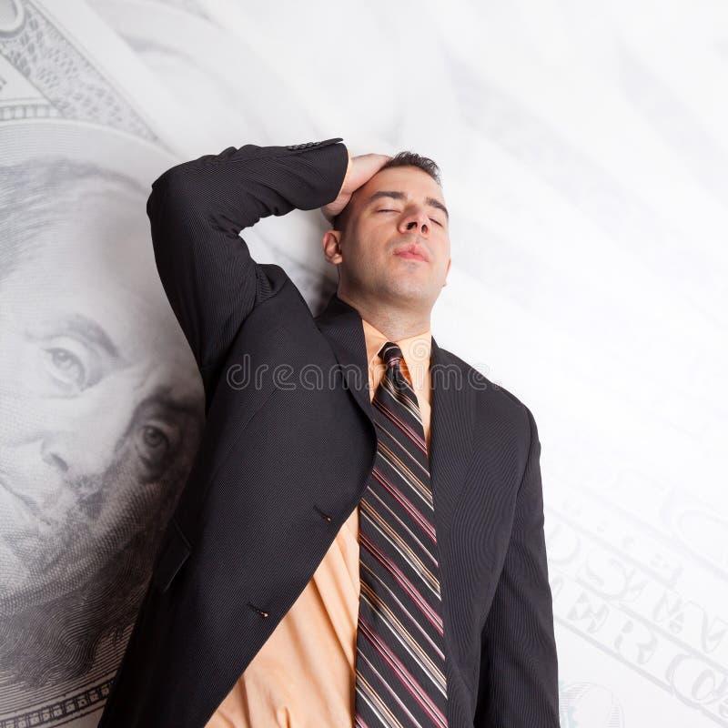 Τονισμένος έξω για τα χρήματα στοκ φωτογραφία