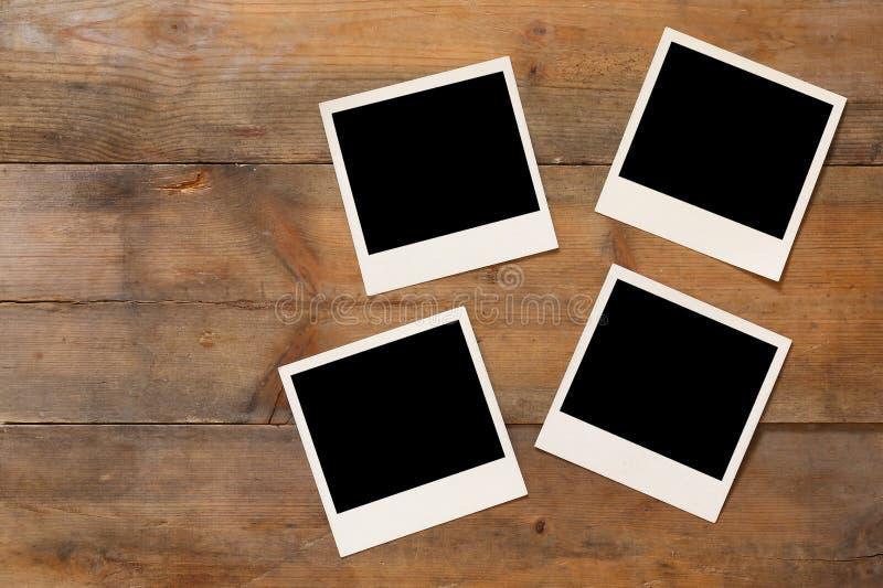 Τοπ άποψη του κενού στιγμιαίου λευκώματος φωτογραφιών στοκ φωτογραφίες