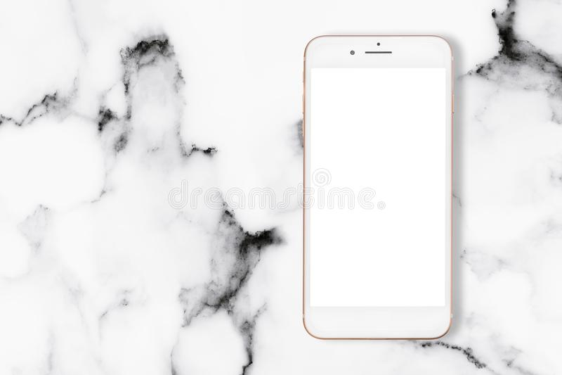 Τοπ άποψη του smartphone στον άσπρο μαρμάρινο πίνακα στοκ φωτογραφίες