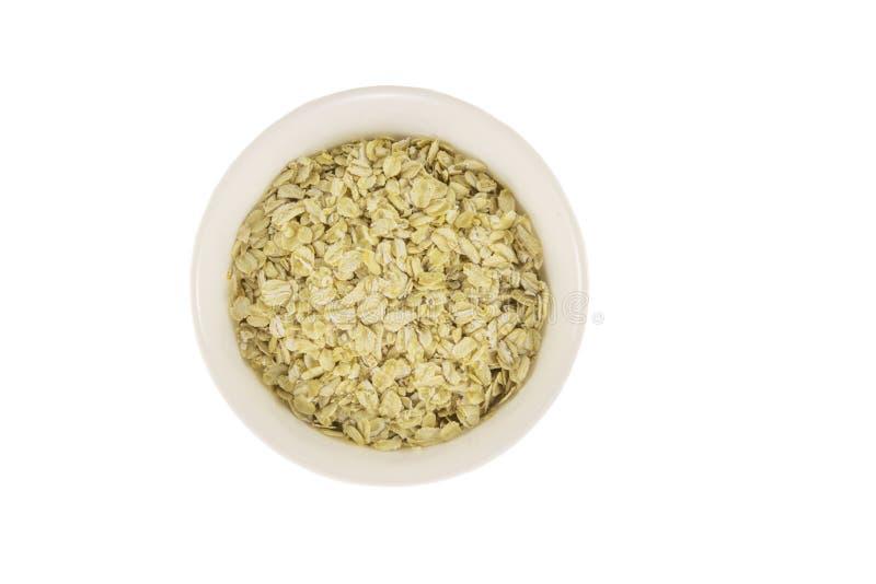 Τοπ άποψη oatmeal στο κύπελλο που απομονώνεται στο άσπρο υπόβαθρο στοκ εικόνες με δικαίωμα ελεύθερης χρήσης