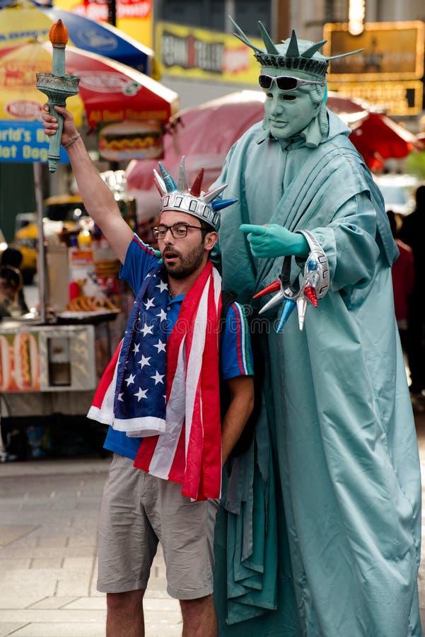 Τουρίστας της Times Square πόλεων της Νέας Υόρκης στοκ φωτογραφία