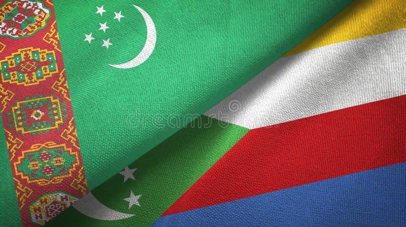 Τουρκμενιστάν και Κομόρες δύο υφαντικό ύφασμα σημαιών, σύσταση υφάσματος ελεύθερη απεικόνιση δικαιώματος