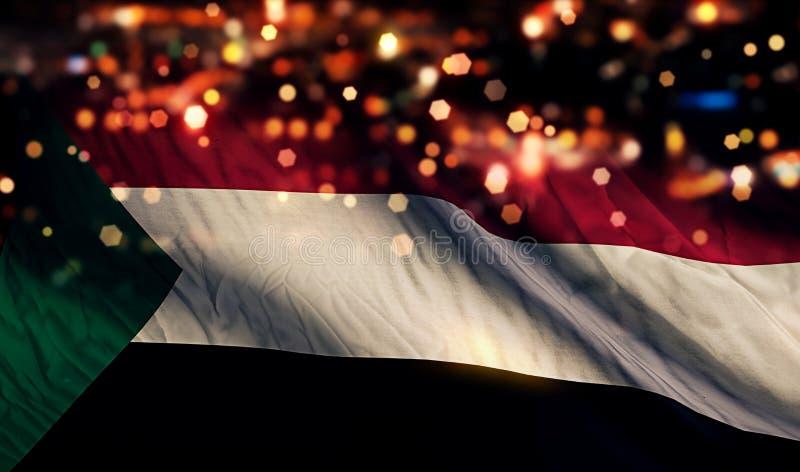 Του Σουδάν αφηρημένο υπόβαθρο Bokeh νύχτας εθνικών σημαιών ελαφρύ στοκ φωτογραφία