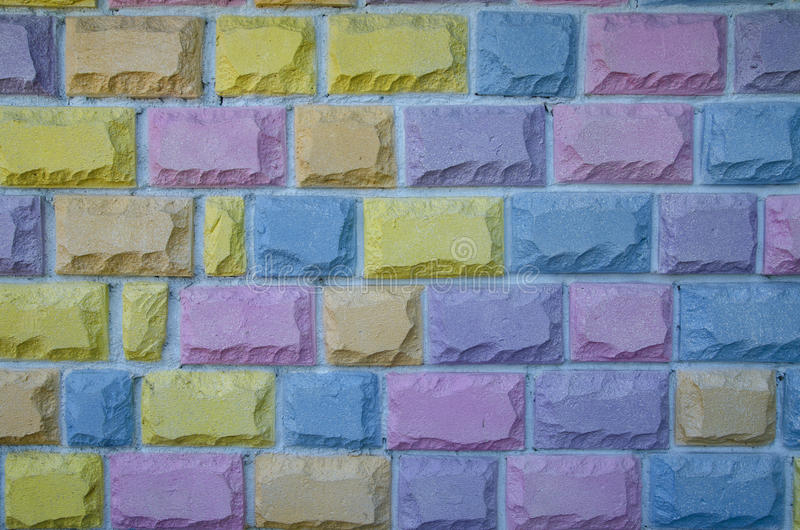 Τούβλα υποβάθρου σε πολλά διαφορετικά χρώματα στοκ φωτογραφία