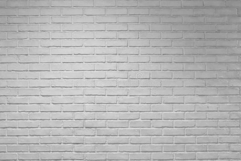 Το άσπρο υπόβαθρο τουβλότοιχος, σύσταση, οριζόντια, δημιουργεί ένα ελαφρύ σκοτάδι στοκ εικόνα
