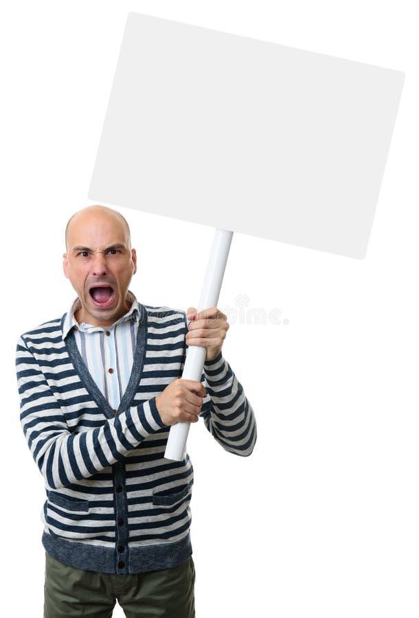 Το άτομο κραυγάζει και κρατά μια κενή αφίσσα στοκ εικόνα με δικαίωμα ελεύθερης χρήσης