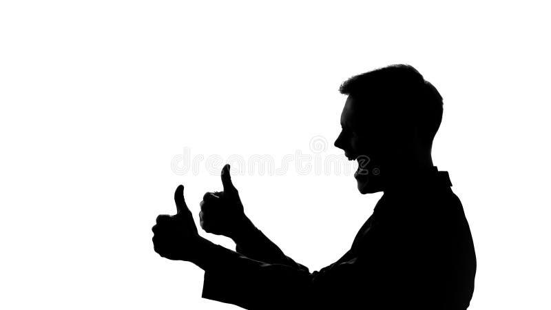 Το άτομο που παρουσιάζει αντίχειρες, σκιαγραφεί την πλάγια όψη, εορτασμός του επιτυχούς ξεκινήματος στοκ εικόνες