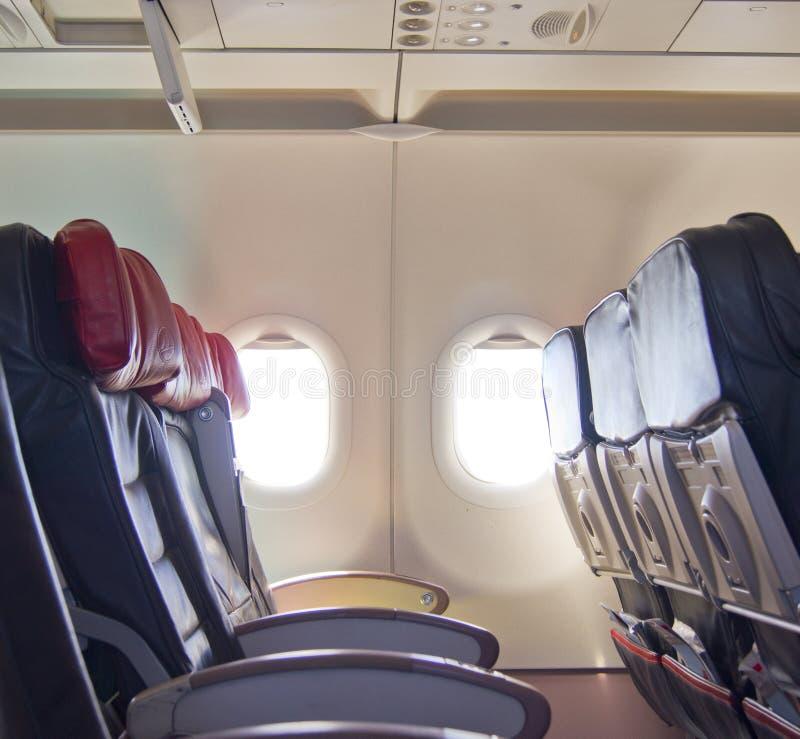 Το αεροπλάνο κάθεται τη σειρά στοκ εικόνα