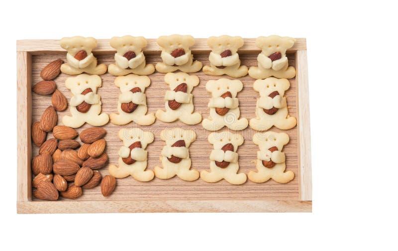 Το αμύγδαλο αφορά τα μπισκότα που απομονώνονται το λευκό στοκ εικόνα με δικαίωμα ελεύθερης χρήσης