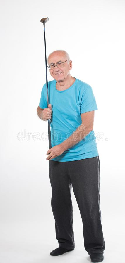Το ανώτερο άτομο παίζει το γκολφ στοκ φωτογραφία με δικαίωμα ελεύθερης χρήσης