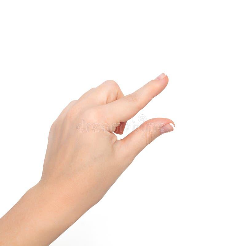 Το απομονωμένο χέρι γυναικών παρουσιάζει το τσίμπημα για να μεγεθύνει ή αντικείμενο εκμετάλλευσης στοκ φωτογραφία