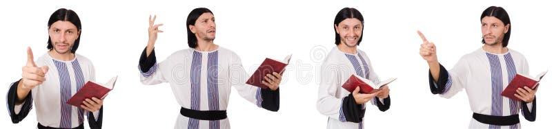 Το αραβικό άτομο με το koran που απομονώνεται στο λευκό στοκ εικόνα με δικαίωμα ελεύθερης χρήσης