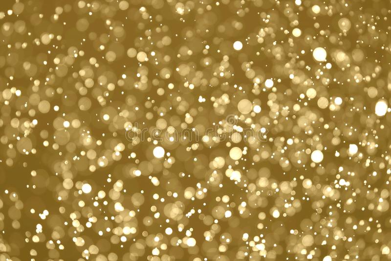 Το αφηρημένο χρυσό φως bokeh το υπόβαθρο στοκ φωτογραφίες