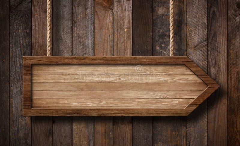 Το βέλος διαμόρφωσε την ένωση σημαδιών στα σχοινιά με το ξύλινο υπόβαθρο σανίδων στοκ φωτογραφία με δικαίωμα ελεύθερης χρήσης