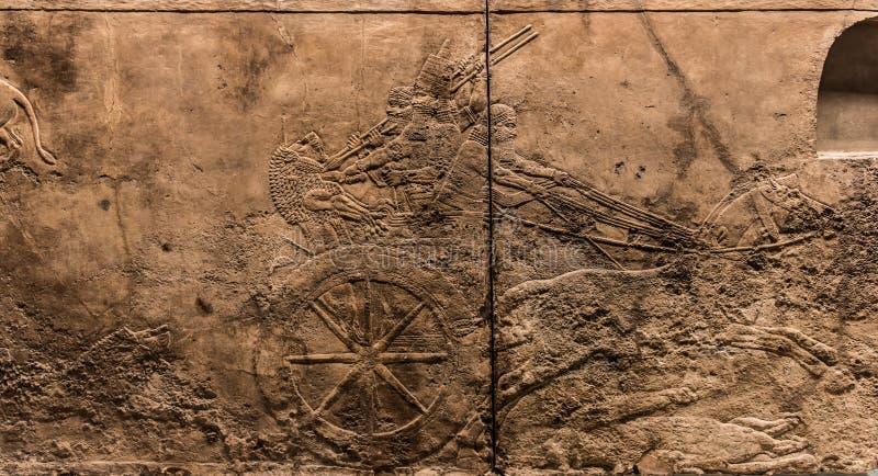 Το βασιλικό λιοντάρι Κυνήγι, φόρμα τέχνης Assyrian 645 - 635 Π.Χ. στοκ εικόνα
