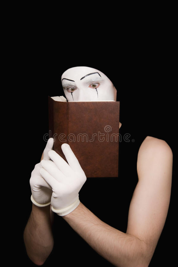 το βιβλίο φορά γάντια mime στο στοκ εικόνες