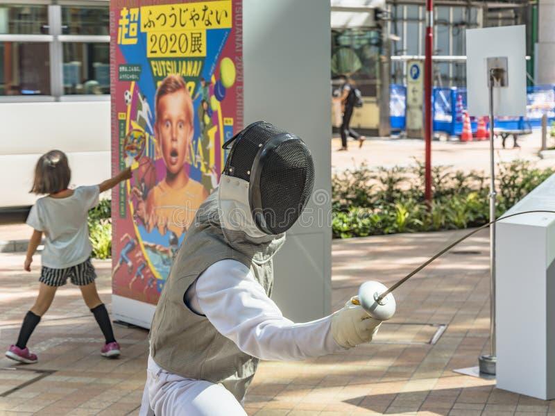 """Το γεγονός """"είναι η αλλαγή Τόκιο το 2020 """"που οργανώνεται στο θέμα των μελλοντικών Ολυμπιακών Αγωνών στο Τόκιο το 2020 στοκ φωτογραφία"""