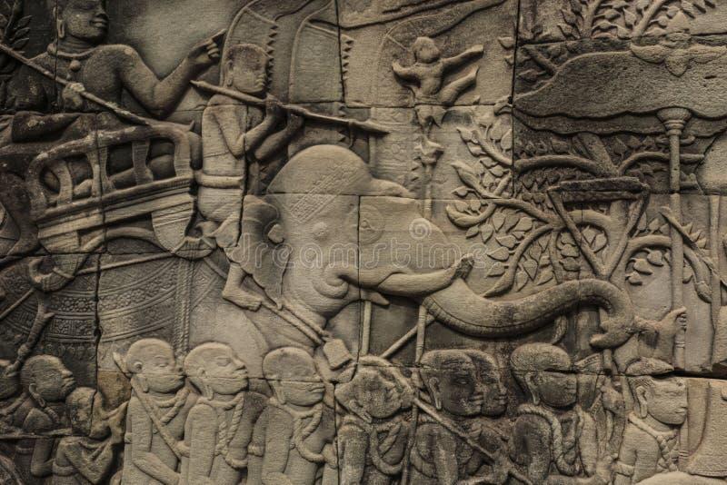 Το γλυπτό bas-ανακούφισης στο ναό Bayon, Angkor Wat, Siem συγκεντρώνει, Καμπότζη στοκ φωτογραφία με δικαίωμα ελεύθερης χρήσης