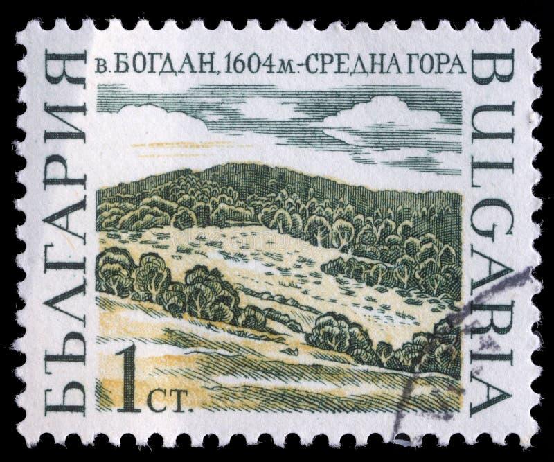 Το γραμματόσημο που τυπώνεται στη Βουλγαρία παρουσιάζει αιχμές βουνών, Bogdan στοκ φωτογραφία με δικαίωμα ελεύθερης χρήσης