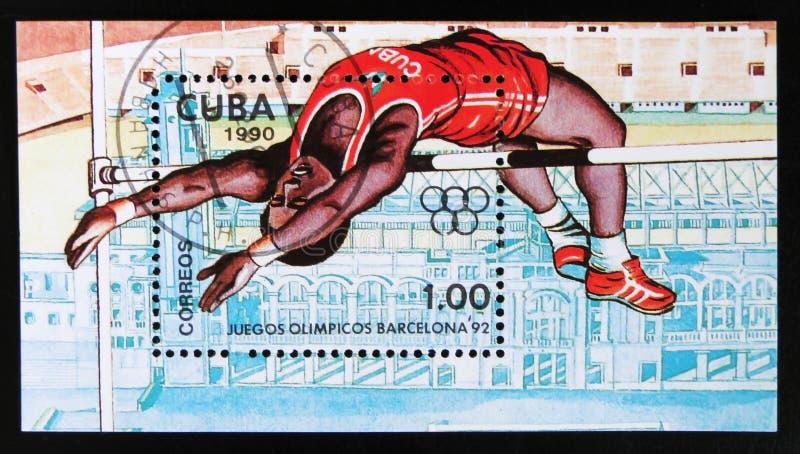 Το γραμματόσημο της Κούβας από τους Ολυμπιακούς Αγώνες, ζήτημα της Βαρκελώνης το 1992 παρουσιάζει υψηλό άλμα, circa το 1990 στοκ εικόνες με δικαίωμα ελεύθερης χρήσης