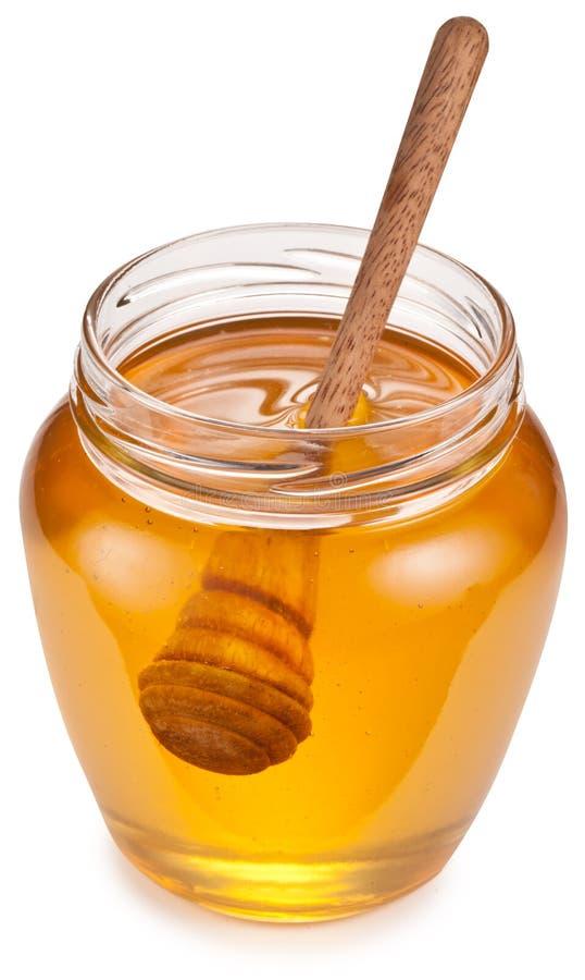 Το γυαλί μπορεί σύνολο του μελιού και του ξύλινου ραβδιού σε το στοκ εικόνες