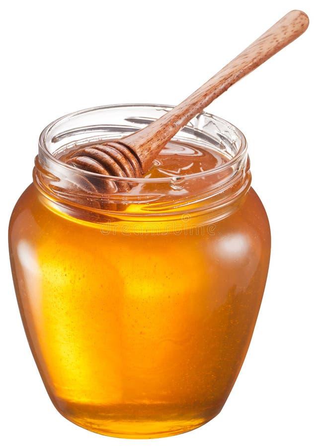 Το γυαλί μπορεί σύνολο του μελιού και του ξύλινου ραβδιού σε το στοκ φωτογραφία