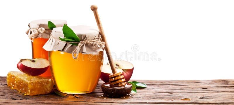 Το γυαλί μπορεί σύνολο του μελιού, των μήλων και των κηρηθρών στοκ εικόνες με δικαίωμα ελεύθερης χρήσης