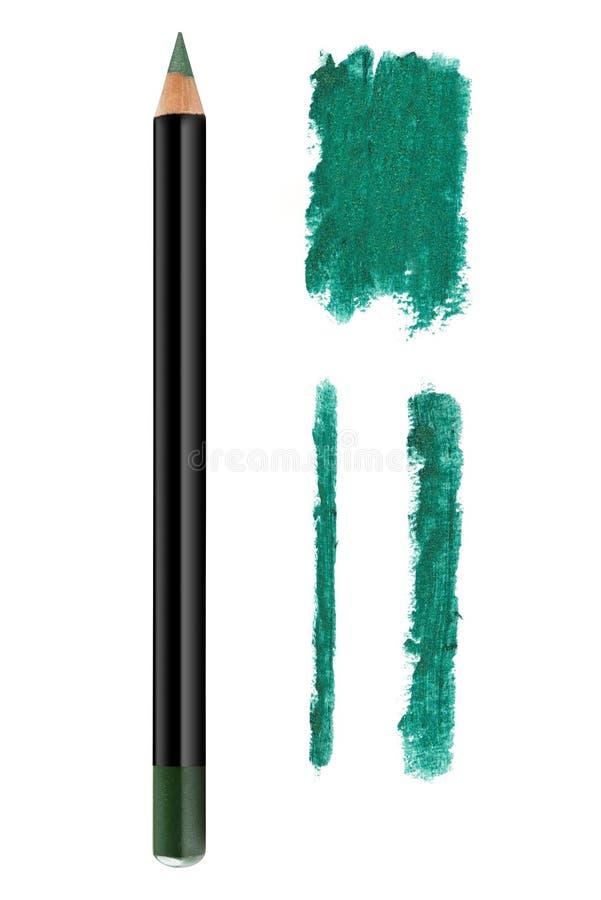 Το δασικό πράσινο μολύβι και τα κτυπήματα eyeliner χρώματος καλλυντικό με ακτινοβολούν μόρια, δείγμα προϊόντων ομορφιάς που απομο στοκ εικόνα