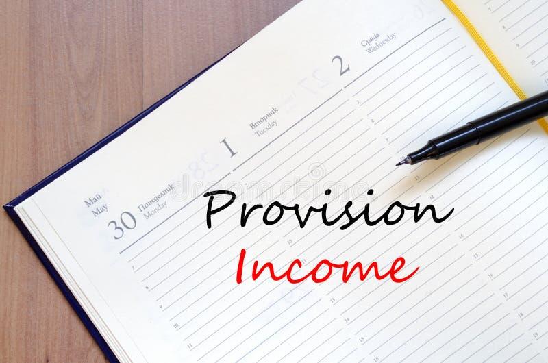 Το εισόδημα παροχής γράφει στο σημειωματάριο στοκ φωτογραφία με δικαίωμα ελεύθερης χρήσης