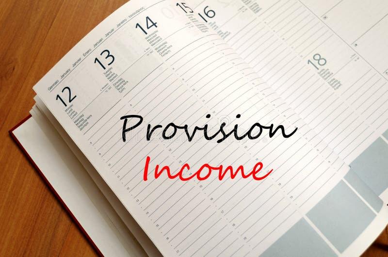 Το εισόδημα παροχής γράφει στο σημειωματάριο στοκ εικόνα με δικαίωμα ελεύθερης χρήσης