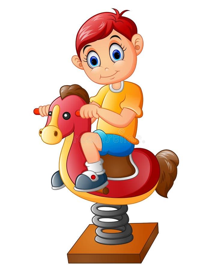 Το ευτυχές παιδί σε ένα άλογο παιχνιδιών ελεύθερη απεικόνιση δικαιώματος
